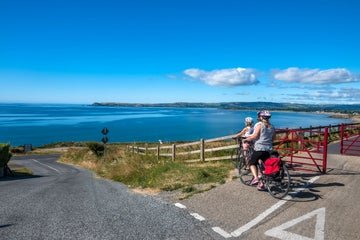 Cyclists taking in the scenic views at Waterford Greenway County Waterford