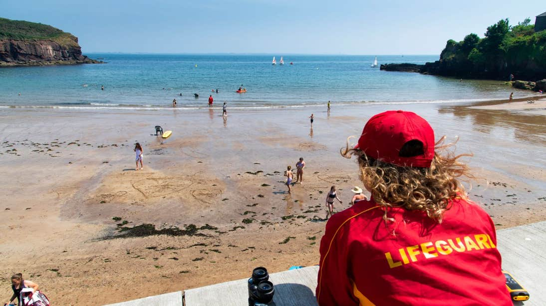A lifeguard watching people swim at Dunmore East, Waterford