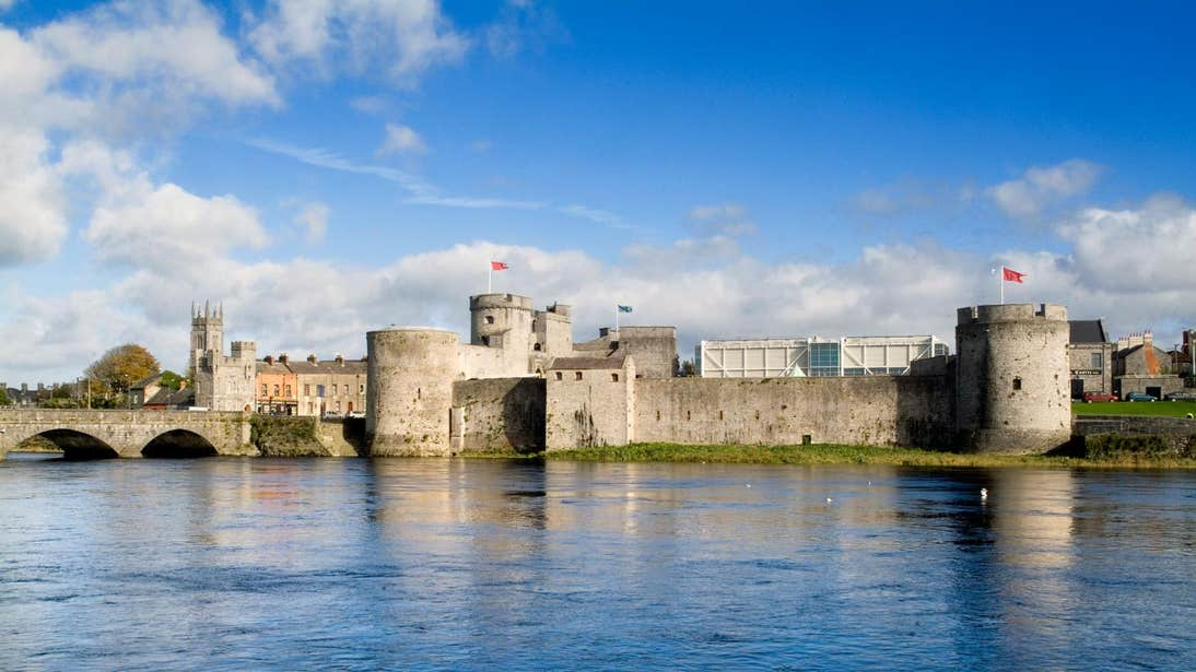 Blue sky and river view with a backdrop of King John's Castle, Limerick