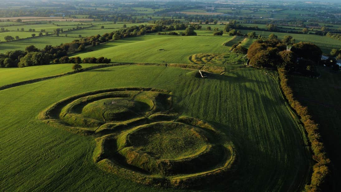 The remains on the Hill of Tara in a green field.