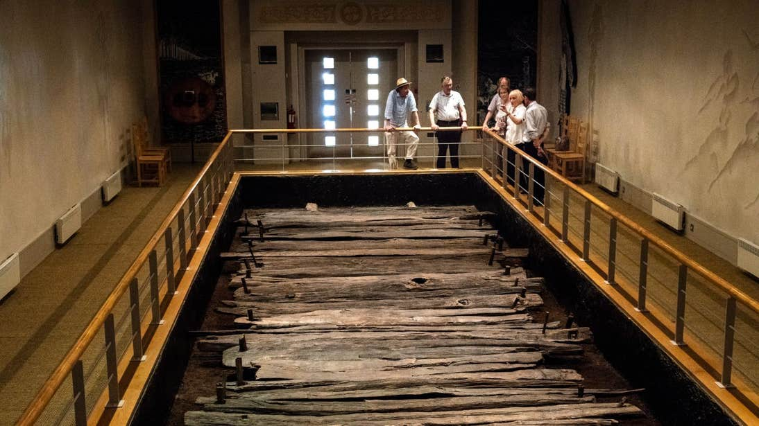 A group of people looking at a display of Corlea Trackway, Longford
