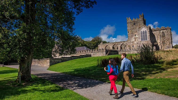 Couple walking towards Tintern Abbey, County Wexford