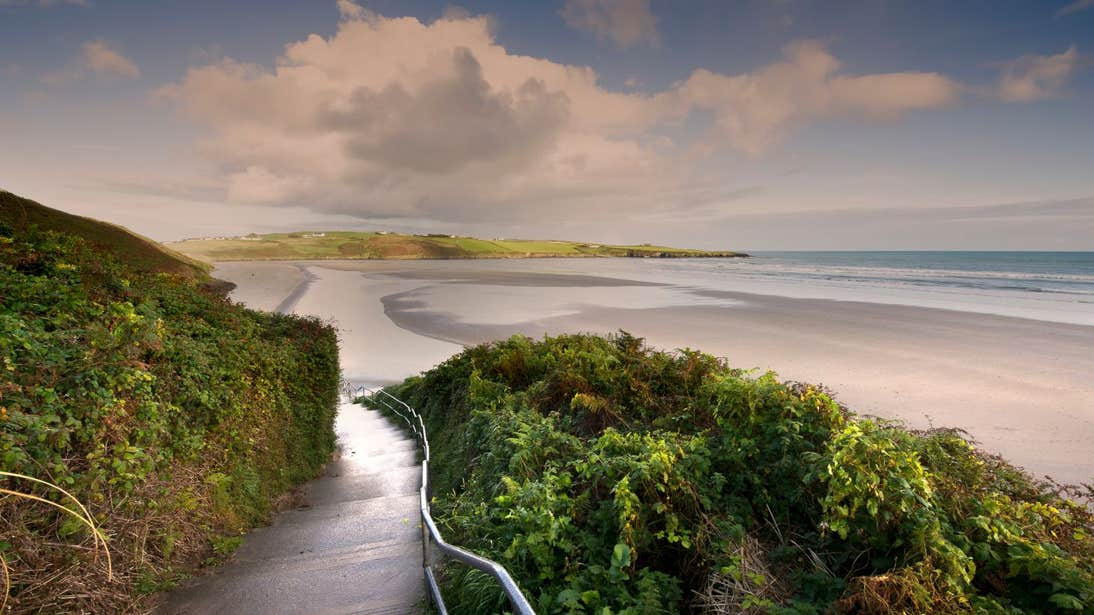 A path leading towards Inchydoney Beach in Cork at sunset