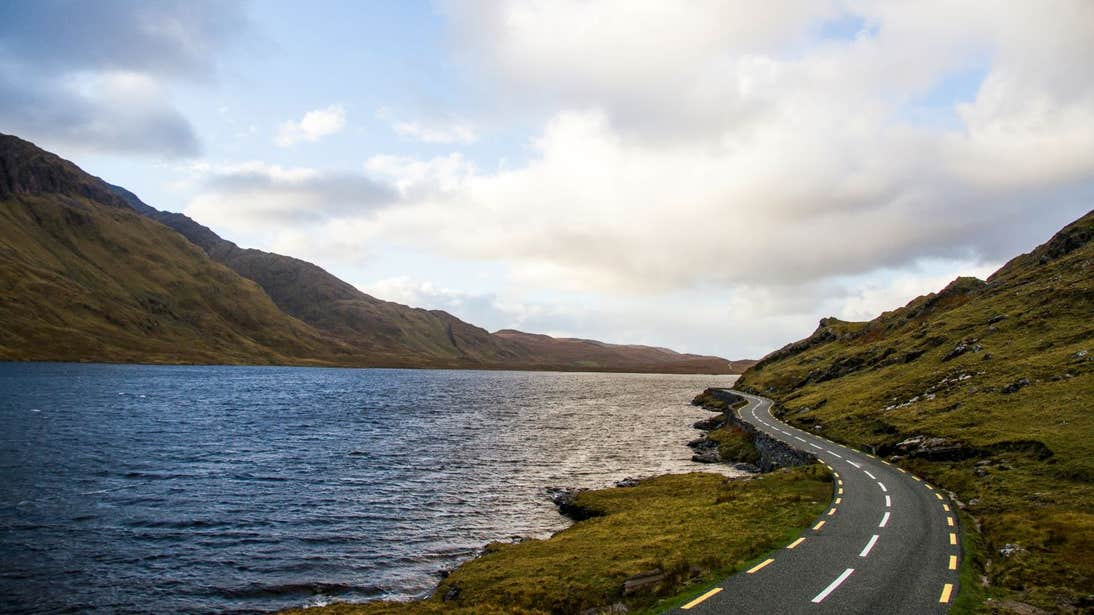 A road beside a body of water in the Doolough Valley, Mayo