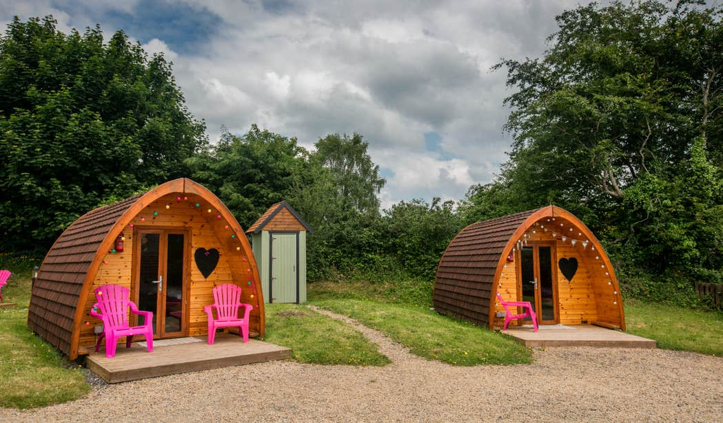 Two wooden glamping huts at Pod Umna Village in Portumna, Galway.