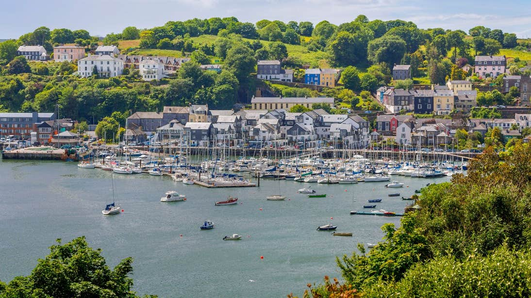 Boats in the water in front of houses in Kinsale Harbour in West Cork
