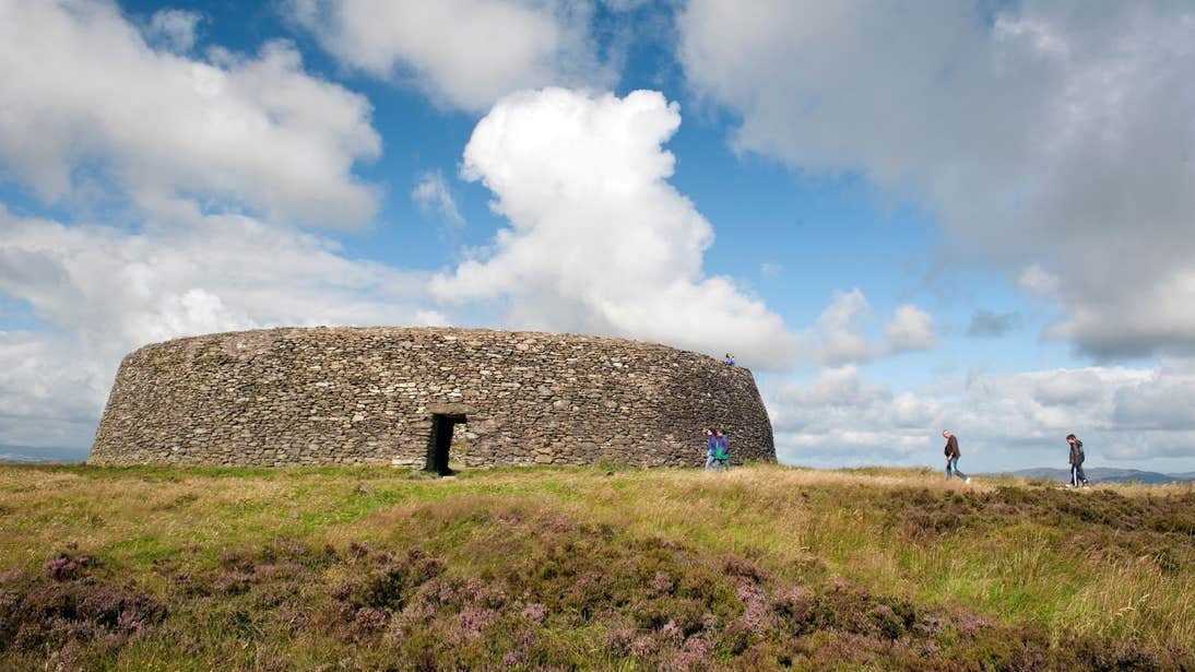 People walking towards the ruins of Grianan of Aileach, Donegal