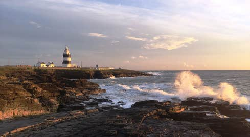 Sunset at Hook Head in Wexford with a lighthouse in the distance
