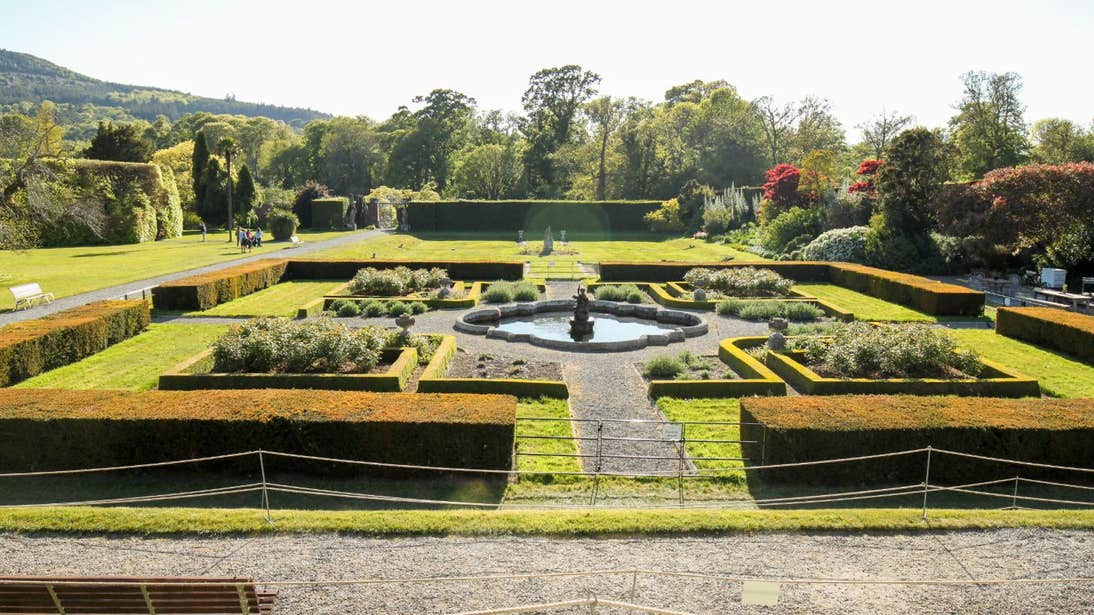 Beautiful gardens with shrubs, trees and a water feature at Killruddery House and Gardens