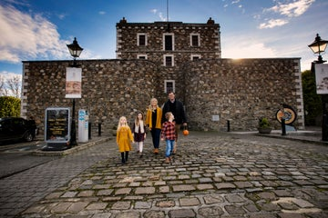 Image of a family outside Wicklow Gaol in County Wicklow