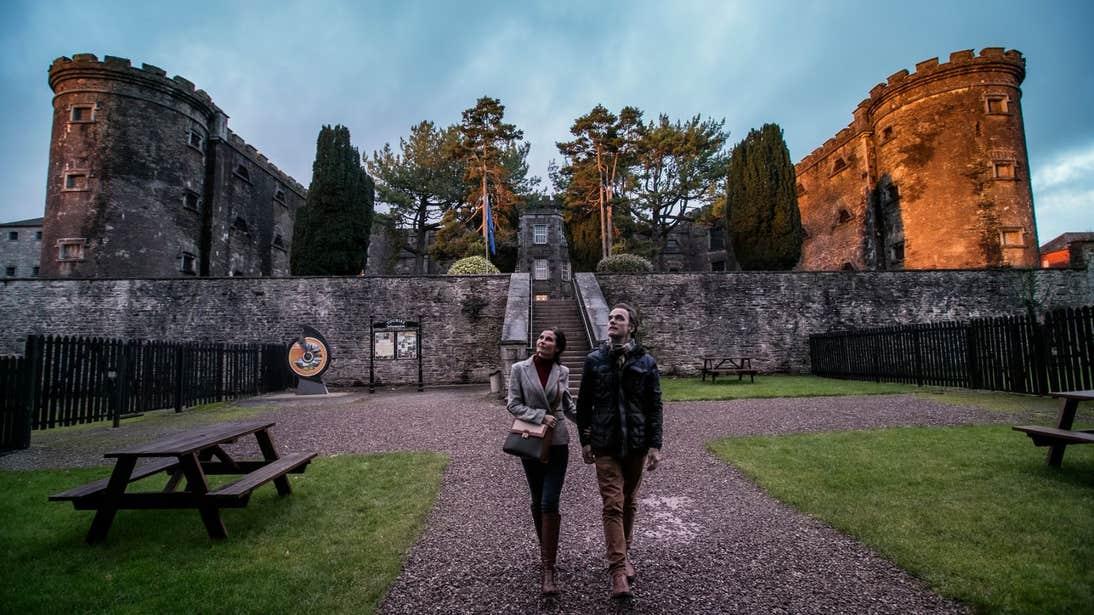 Couple walking through Cork City Gaol