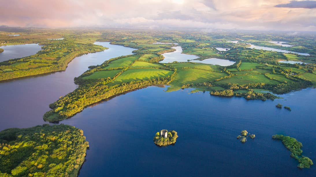 Clough Oughter Castle surrounded by water in the middle of a lake in County Cavan
