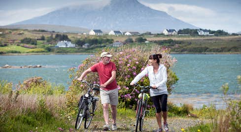 Two cyclists enjoying mountain views on Great Western Greenway, Mayo