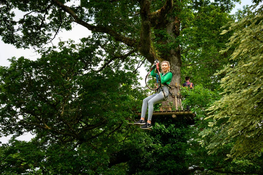 Girl using a zipline at Lough Key Forest and Activity Park