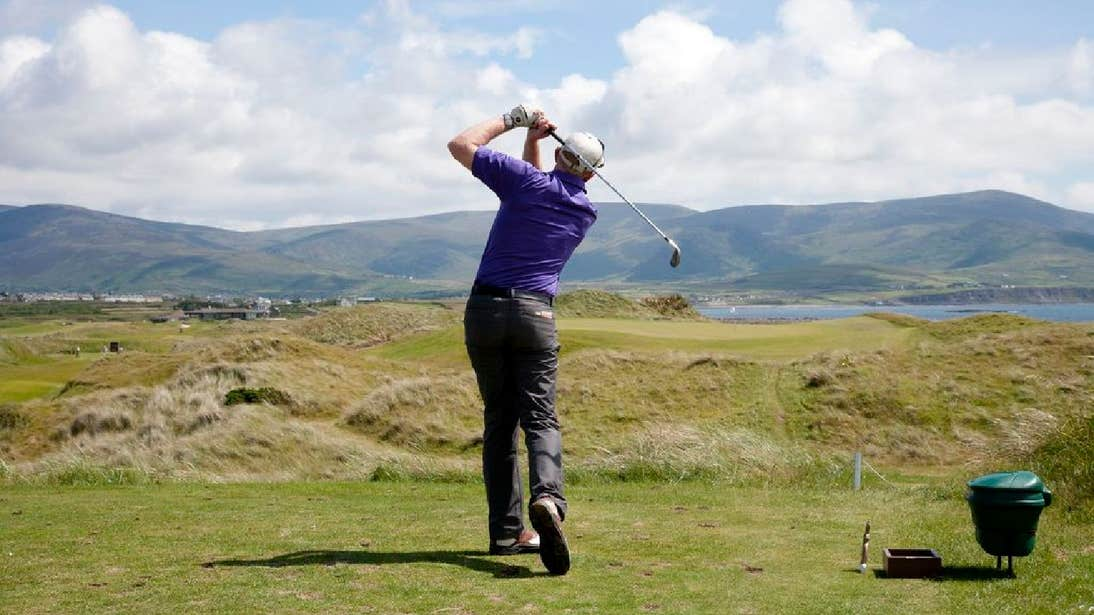 Man playing golf with mountains in the background Waterville Golf Links County Kerry