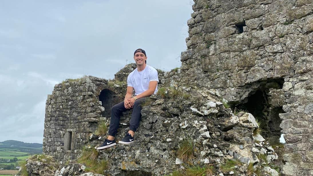 Greg O'Shea sitting on ruins at the Rock of Dunamase, Laois