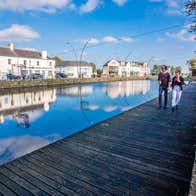 A couple walk the boardwalk along by the Royal Canal in Maynooth