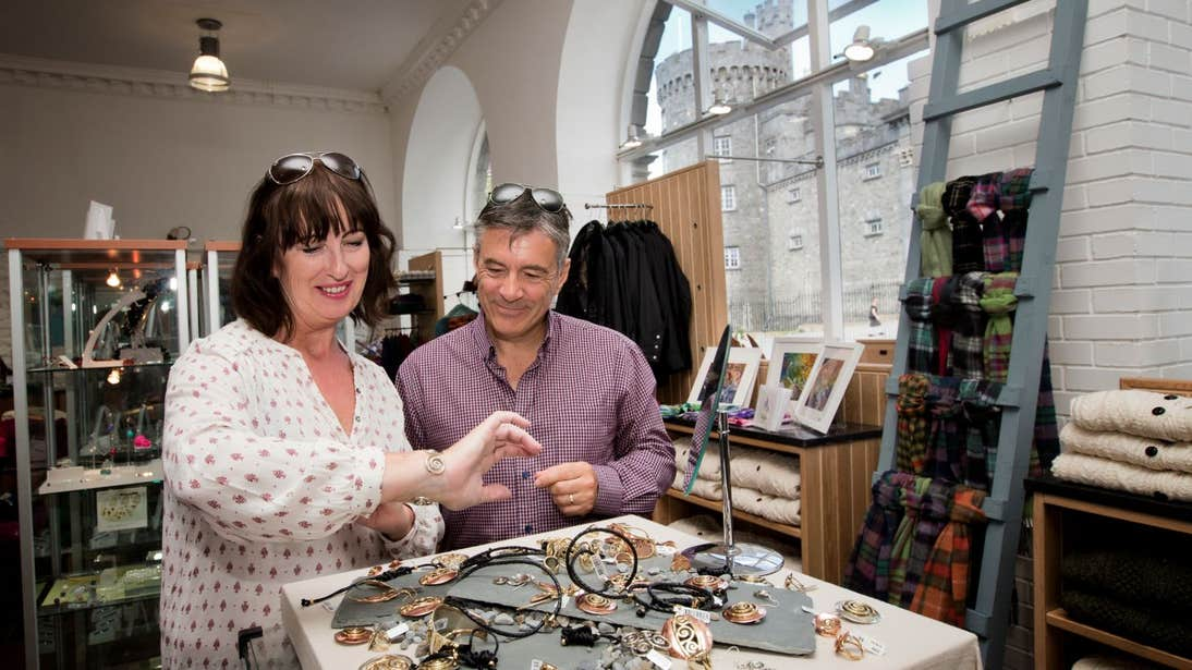 A man and women looking at jewellery at Kilkenny Design Centre