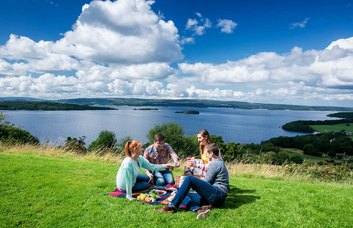 Four people enjoying a picnic at The Lookout Portroe Tipperary