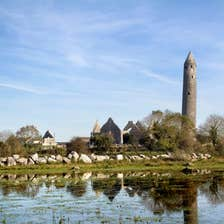 Round tower and churches at Kilmacduagh Monastic Site, County Galway