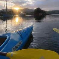 A view of the sunrise across the harbour visible from the kayaks