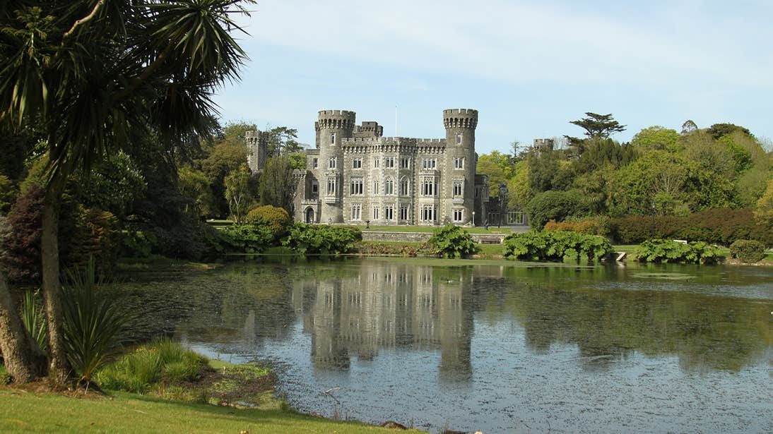 Johnstown House beside a lake in Wexford surrounded by trees