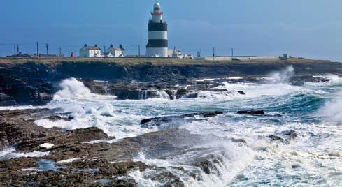 Crashing waves on the rocks beside Hook Lighthouse Co Wexford