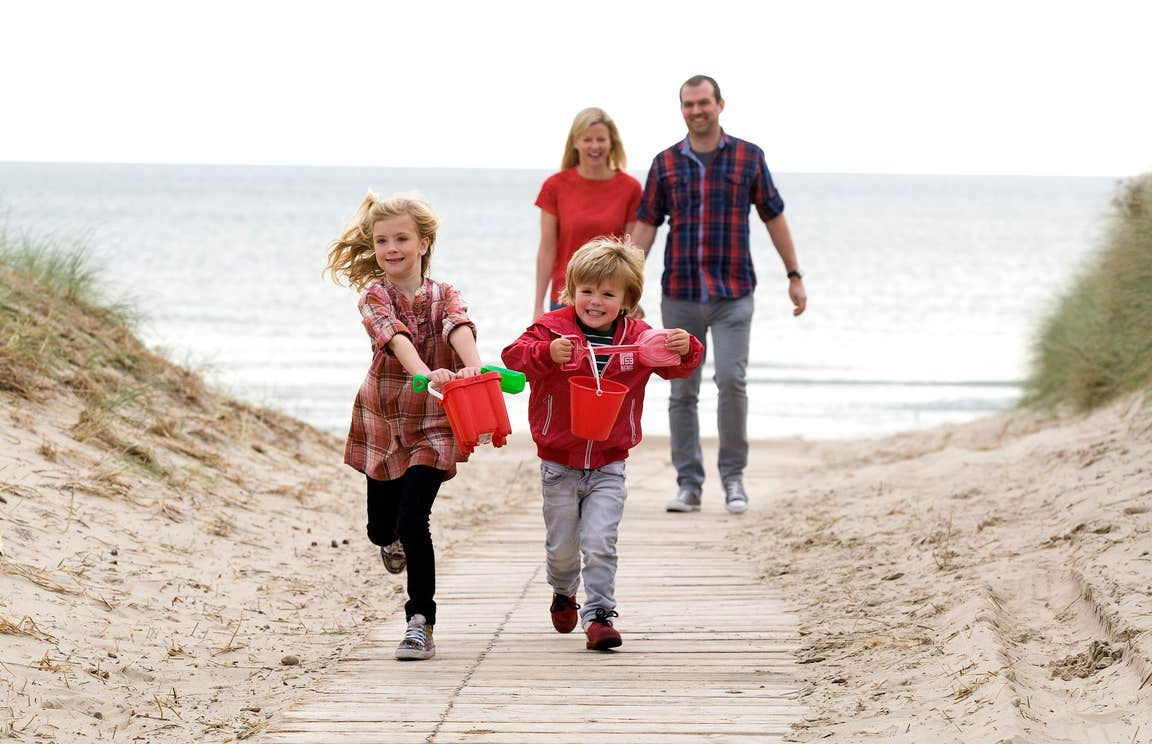 A family playing on Curracloe Beach, Wexford