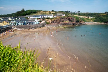 Groups of people swimming in Dunmore East in County Waterford