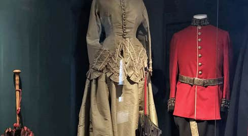 Image of lady's gold coloured costume and red military costume