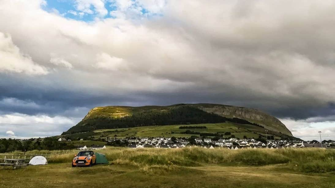 Tents and a car in from of a mountain at Strandhill Caravan and Camping Park, Strandhill, Sligo