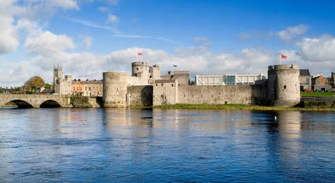 Just outside the walls of King John's Castle, Limerick with blue water and blue skies