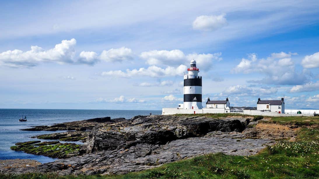 Calm waters near rocks and lighthouse on Hook Head