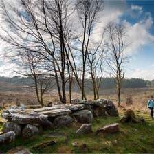 Two people walking through the natural landscape of the Cavan Burren Park, one of the best things to do in Cavan