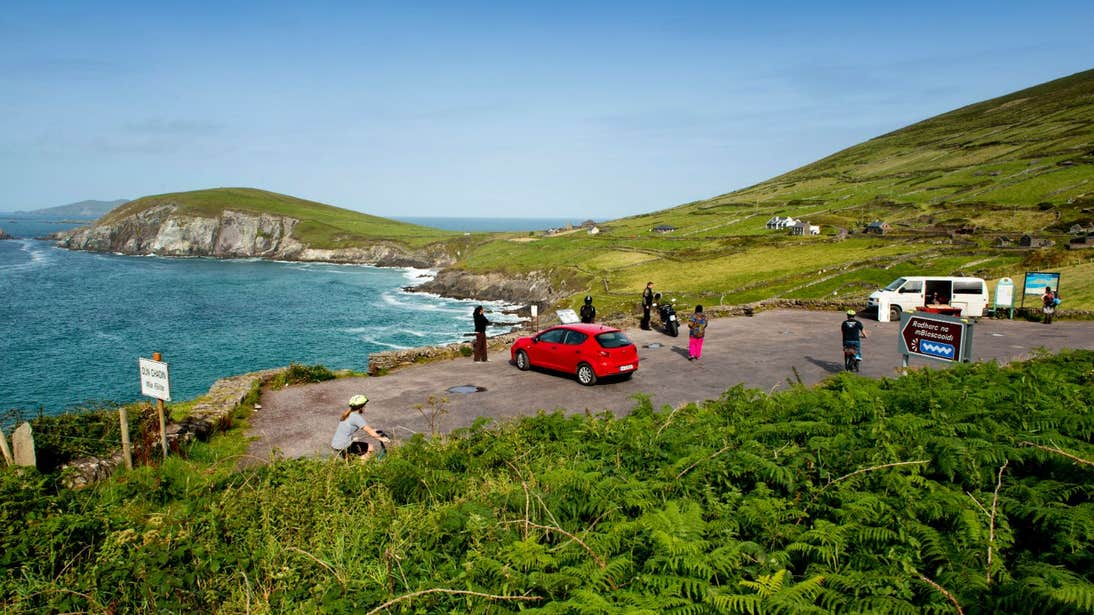 Groups of drivers and cyclists taking the view at Slea Head, Co. Kerry