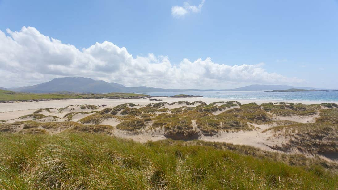 A sunny day at Silver Strand, Louisburgh, Mayo with mountains in the background.