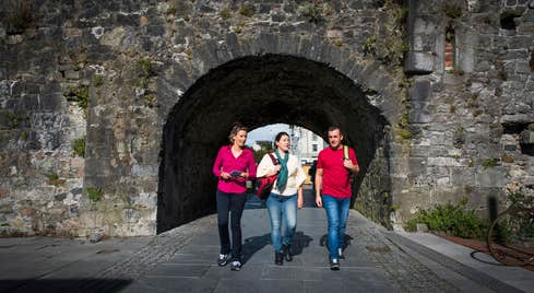 Friends walking through the Spanish Arch, Galway City