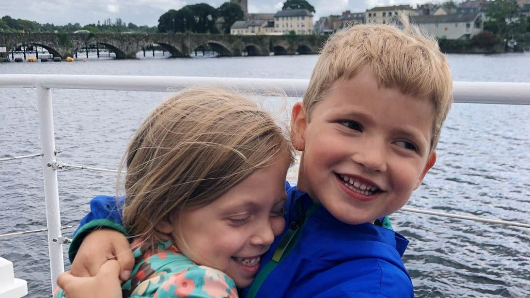 Two children laughing and smiling in Killaloe, Clare