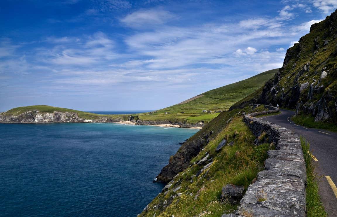 A road and stone wall leading to a beach on Slea Head, Dingle, Kerry