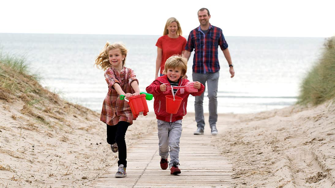 Children and adults having fun at the beach in Curracloe Beach, Wexford