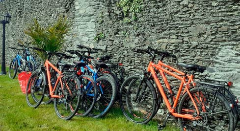 Bikes left up against a stone wall