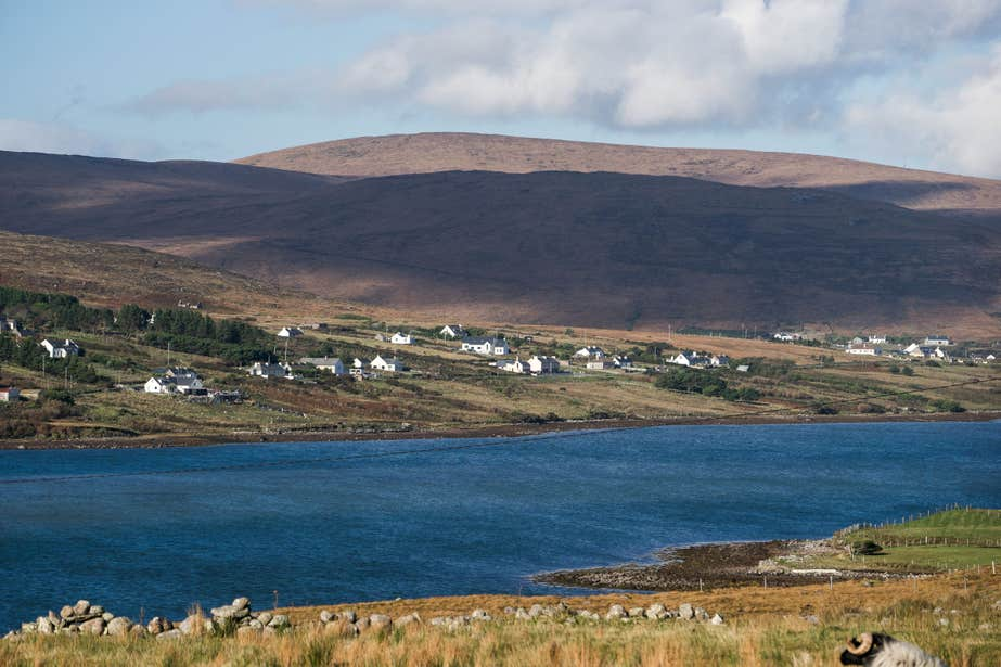 Houses near water on Inishbofin Island in County Galway