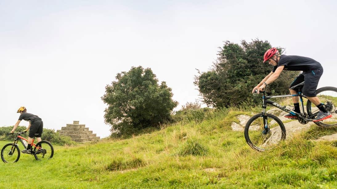 Two people mountain biking, County Dublin