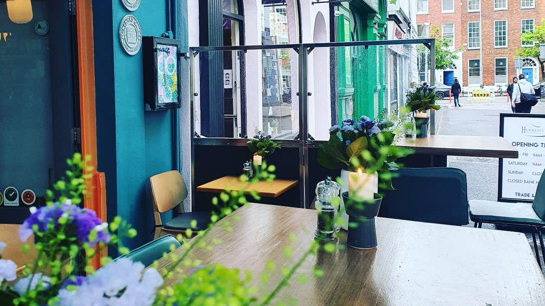 Fresh flowers in a colourful outdoor dining area at Orso Kitchen and Bar, Cork City