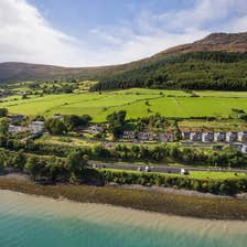 An aerial view of water and green hills in Carlingford