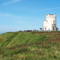 Visitors at O Briens Tower on a bright day with blue skies
