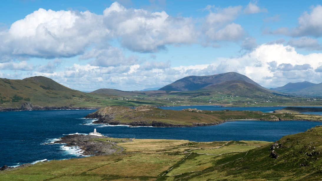 Mountains beside the sea and lighthouse on Valentia Island, Kerry