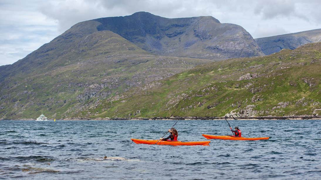 Two people kayaking across Killary Harbour in Galway.