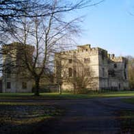 Trees in front of a large house in a park in Donadea Forest Park, County Kildare.