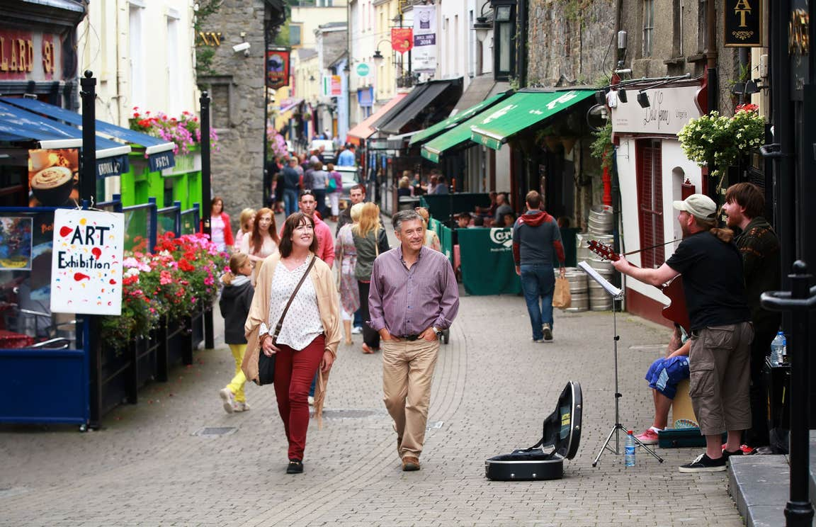Couple walking down lively streets in Kilkenny City